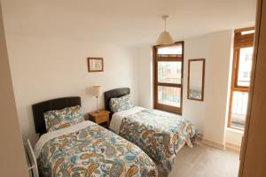A bed or beds in a room at Sweet home in the heart of Dublin city