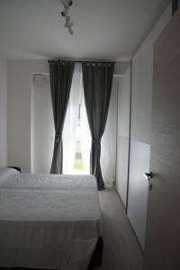 A bed or beds in a room at Casa sprint