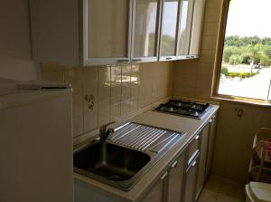 Cucina o angolo cottura di Residence Atlante