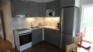 A kitchen or kitchenette at Zorbcenter Holiday Homes
