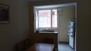 Гостиная зона в Apartment in Lodochniy Kooperativ