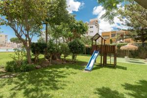 Children's play area at Apartamentos Nucleo Cristal