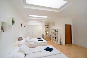 Ein Bett oder Betten in einem Zimmer der Unterkunft Holiday House in the Center of Prague