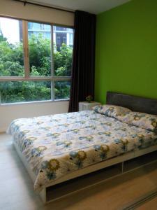 เตียงในห้องที่ Dcondo Hyde Chiang Rai by AJ