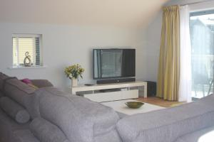 A television and/or entertainment center at 9 Sandpiper Cottages