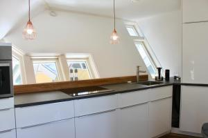 A kitchen or kitchenette at Cubehouse City-Centre Rotterdam