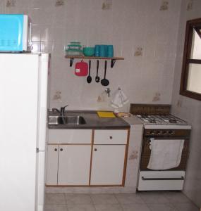Una cocina o kitchenette en Departamento Centro Cívico