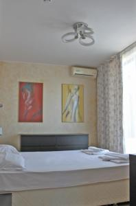 A bed or beds in a room at Tarsis Club - All Inclusive Premium