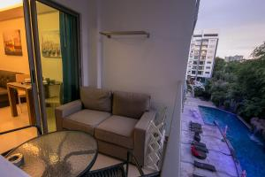 Вид на бассейн в Sanctuary Wongamat Apartment 1-Bedroom или окрестностях