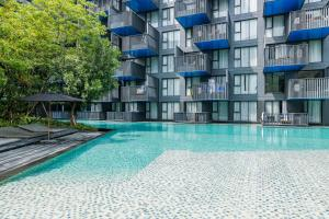 The swimming pool at or near The Deck Patong Condo by Joy
