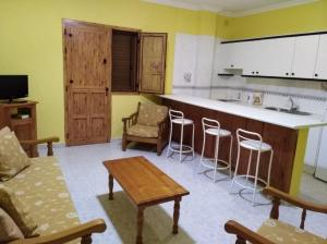 A kitchen or kitchenette at Apartamentos La Banda