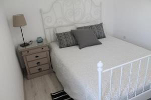 Uma cama ou camas num quarto em Charming baixa