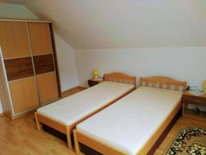 A bed or beds in a room at Apartmán 80