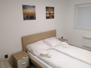 Postel nebo postele na pokoji v ubytování Vila Marianna