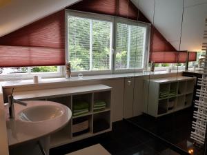 Ein Badezimmer in der Unterkunft Villa Papagena