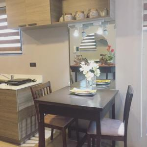 A restaurant or other place to eat at Condo-unit near Marikina and Pasig