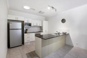 A kitchen or kitchenette at Tropical private holiday house with pool