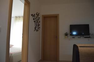 TV/Unterhaltungsangebot in der Unterkunft Apartment Ferara