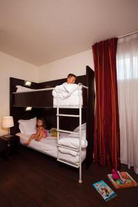 A bunk bed or bunk beds in a room at Residhome Val d'Europe