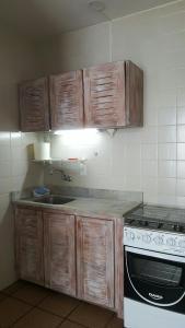 Una cocina o zona de cocina en CRETA 1 ANDAR
