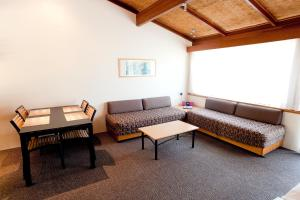 A seating area at Nautilus Beachfront Villas & Spa