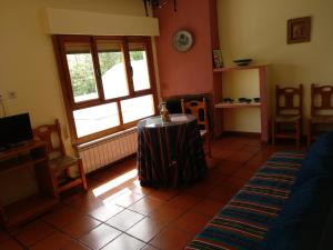 Ein Sitzbereich in der Unterkunft Apartamentos Turísticos Rural Los Tinaos
