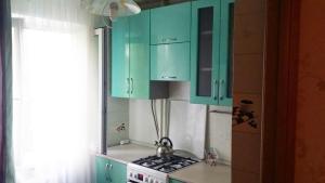 A kitchen or kitchenette at Apartaments na Kirova