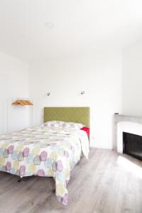 Un ou plusieurs lits dans un hébergement de l'établissement Aux Iles d'Or