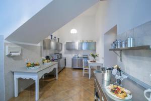 A kitchen or kitchenette at villa virginia