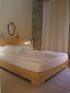 A bed or beds in a room at Gite la Tour