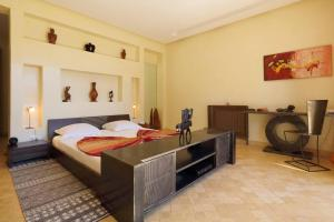 A bed or beds in a room at Villa Kristy