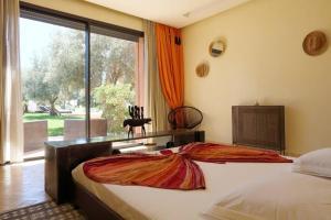 Llit o llits en una habitació de Villa Kristy
