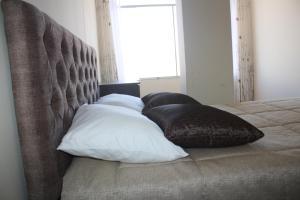 Cama o camas de una habitación en Qosqo Tampu Hotel