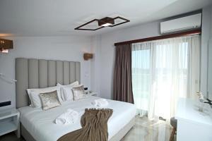 Un pat sau paturi într-o cameră la Imagine Studios