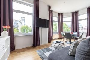 Ein Sitzbereich in der Unterkunft Freiburg Apartments Friedrichring