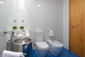 Et badeværelse på Casas da Pescaria A