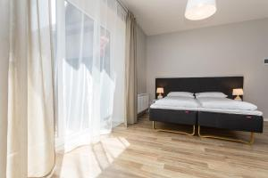 A bed or beds in a room at Liepų 16