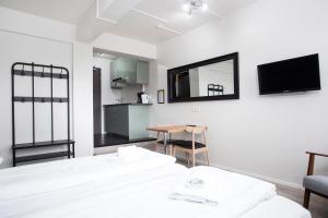 Un televizor și/sau centru de divertisment la Stay Apartments Bolholt