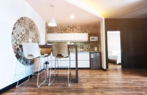 A kitchen or kitchenette at Urban Suites