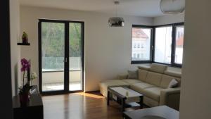Uma área de estar em Apartment UMM