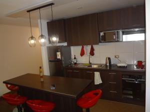 Una cocina o zona de cocina en Apartamento acolhedor