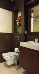 A bathroom at Continental Apartament przy plazy