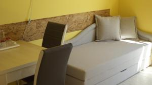 A bed or beds in a room at Bella Vista