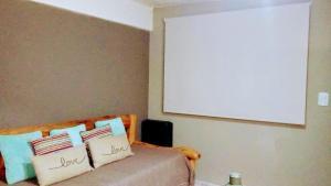 Una cama o camas en una habitación de Departamentos Lugar de Descanso