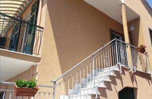 A balcony or terrace at A & M HOUSE