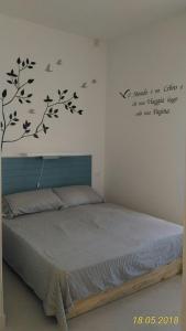 מיטה או מיטות בחדר ב-Condominio Le palme