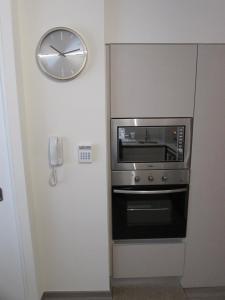 Una cocina o zona de cocina en Santiago Central Suites / San Martin