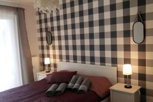 Łóżko lub łóżka w pokoju w obiekcie Apartament Solna 106