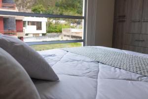 Voodi või voodid majutusasutuse Hidden House toas