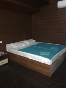 A bed or beds in a room at Lidzava City